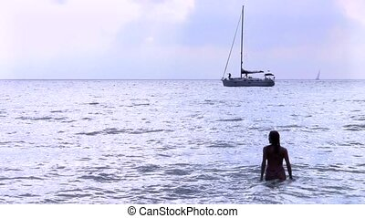 silhouette of girl - seascape with silhouette of fit woman...