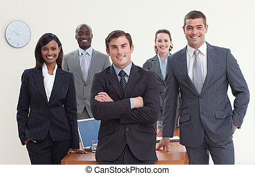 Confident business team standing in a meeting and smiling at...