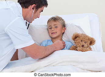 Doctor listening to a child breaht with stethoscope - Doctor...