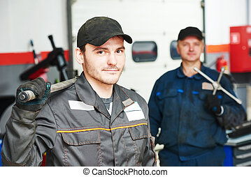 two auto mechanic repairmans - Two repairmans auto mechanic...