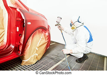 car painting in chamber - auto painting worker. red car in a...