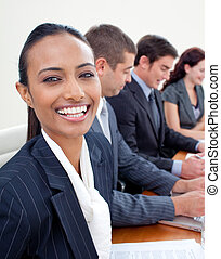 Beautiful Indian businesswoman in a meeting smiling at the...