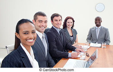 Business team talking in a meeting - Young business team...