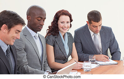 Smiling businessmen working in a meeting