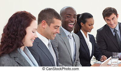 Happy businessman working in a meeting