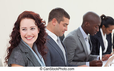 Smiling businesswoman talking in a meeting