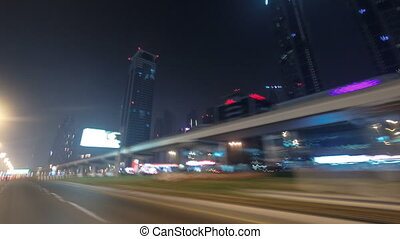 Drive on Sheikh Zayed Road in Dubai at night, United Arab...