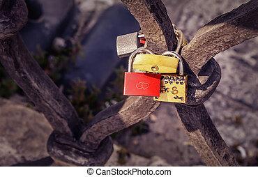 Love padlocks - Old love padlocks on the fence of the bridge