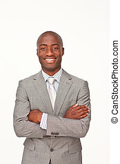 Smiling Afro-American businessman with folded arms against...