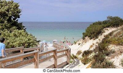 italian seaside - wooden walkway to access a sunny...