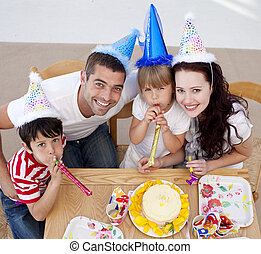 Little girl celebrating her birthday with her family - High...