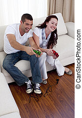 Lovers playing video games together in living-room