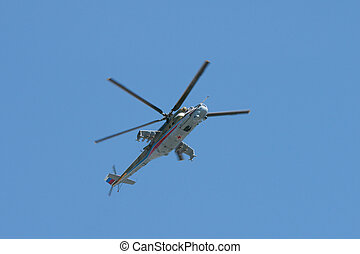 armed helicopter - russian armed helicopter over blue sky,...