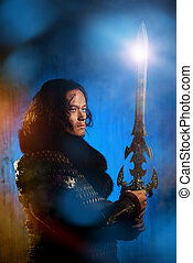 reenactment - Ancient male warrior in armor holding sword...