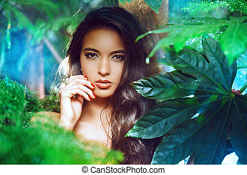 complexion - Beautiful young woman on a background of green...