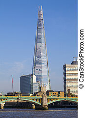 The Shard and Southwark Bridge in London - A view of the...