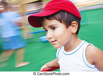 boy playing on the playground - Soft focus portrait of a 3-4...