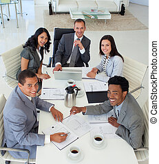 Smiling business people working in a meeting - Multi-ethnic...