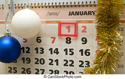 Calendar and New Year\'s ornaments. - Page of a calendar for...