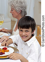 Portrait of a boy having dinner with his family