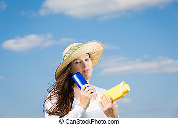 protection against skin cancer - woman against blue sky...
