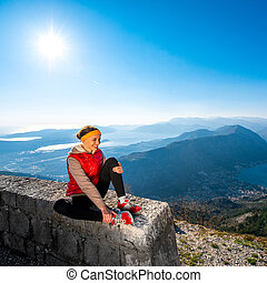 Sport woman resting on the mountain - Sport woman resting...