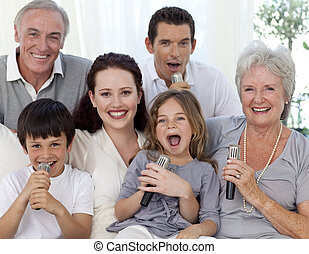 Family singing karaoke at home