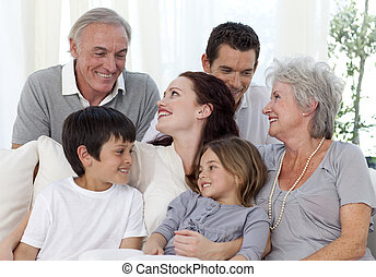 Portrait of family sitting on sofa - Portrait of happy...