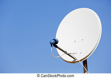 Common satellite dish against sky - Common residential...