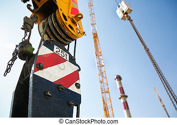 Pulley of a mobile lifting crane on a construction site,...