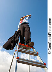 Business vision - Businessman, standing on a ladder,...