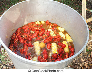 Kettle full of crawfish at a crawfish boil - A boiling pot...