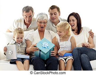 Family opening presents in grandmothers birthday - Family at...