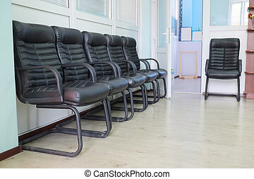 leather chairs - Leather chairs in a row