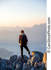 Young photographer on the top of mountain - Young traveler...
