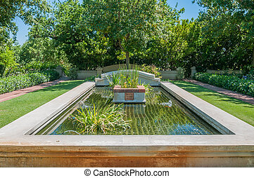 Formal garden on a farm near Paarl - Formal garden with fish...