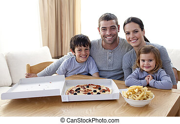 Family eating pizza and fries