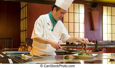 Chef working in Japanese restaurant - Cooking vegetables....