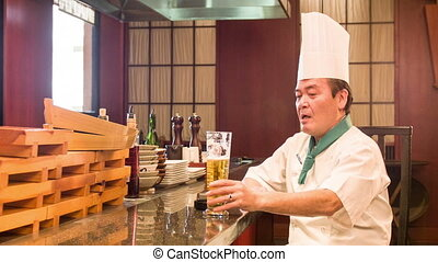 Satisfied Japanese chef sitting in kitchen - Relaxation...