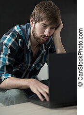 Lazy man using laptop - Vertical view of lazy man using...