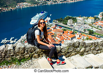 Woman traveling in old city Kotor, Montenegro - Young woman...