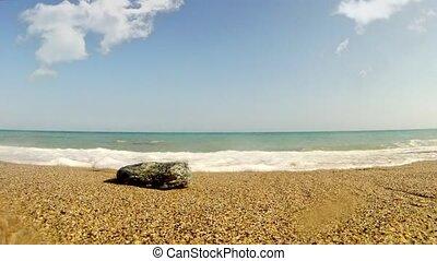 A stone on a golden beach