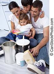 Family chosing colours to paint a bedroom - Happy family...
