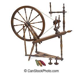 Antique spinning wheel with yarn and bobbins isolated on...