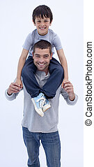 Father giving son piggyback against white - Father giving...