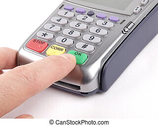 Payment terminal with keypad and a finger pressing green OK...