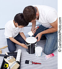 Father and son preparing paint