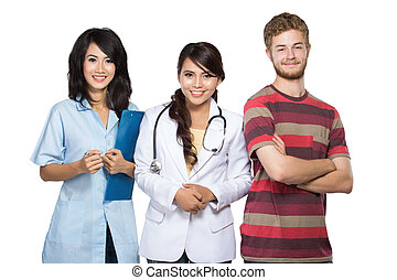 doctor, nurse, and patient smiling