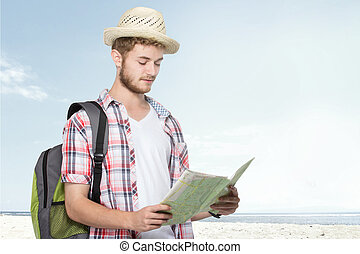 young traveling man reading map - portrait of a young...