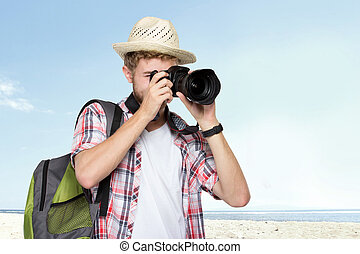 young traveling man taking a picture